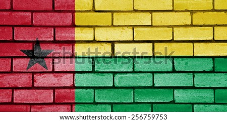 Guinea Bissau flag painted on old brick wall texture background - stock photo