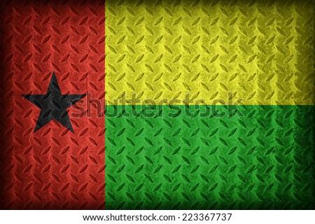 Guinea Bissau flag pattern on the diamond metal plate texture ,vintage style - stock photo