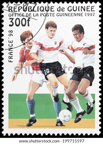 GUINEA - CIRCA 1997: A stamp printed in Guinea, shows a footballer, 1998 FIFA World Cup, series France '98, circa 1997 - stock photo