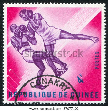 GUINEA - CIRCA 1963:   stamp printed by Guinea,  shows boxing, circa 1963. - stock photo