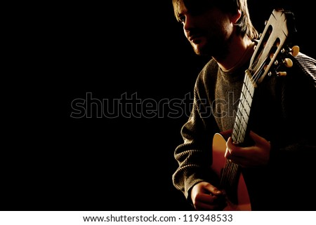 Guitar acoustic Guitarist playing classic music instrument closeup isolated on black - stock photo