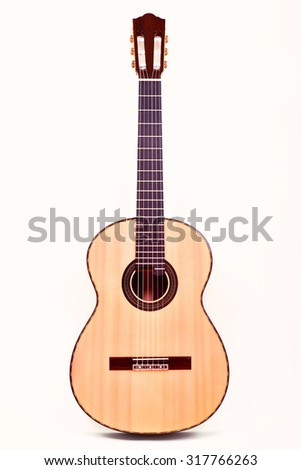 guitar acoustic nylon upright - stock photo