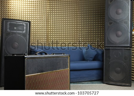 Guitar amplifier and audio system in recording studio. - stock photo
