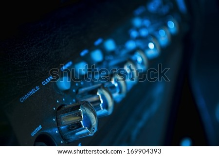 guitar amplifier knobs closeup - stock photo