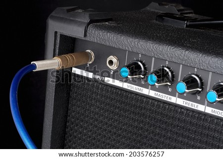Guitar amplifier on black - stock photo