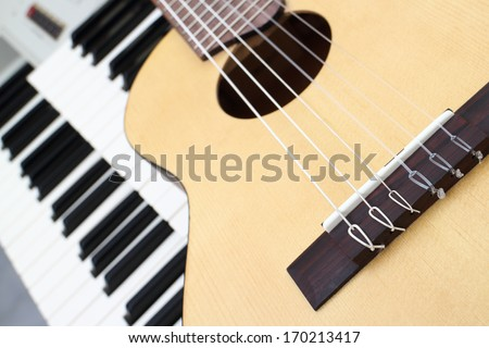 guitar and keyboard musical instruments - stock photo