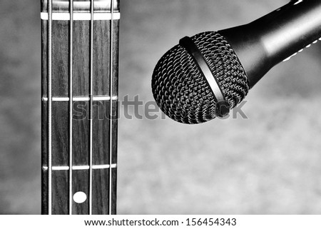 Guitar and microphone - stock photo