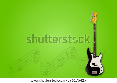 Guitar and notes on salad background - stock photo