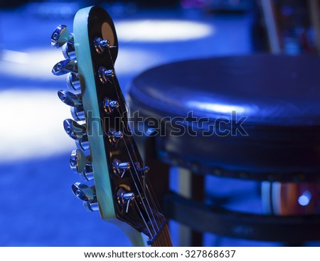 Guitar and other musical equipment on stage before concert - stock photo