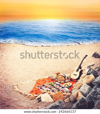 Guitar  at seascape sunset background - stock photo