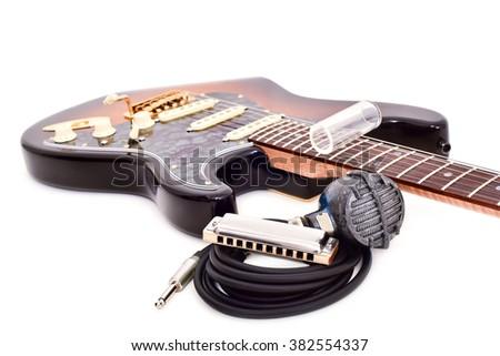 guitar blues bottleneck harmonica microphone cord  - stock photo