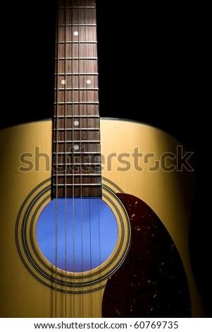 Guitar closeup, illuminated interior - stock photo