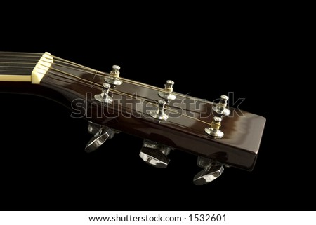 Guitar head over black background - stock photo