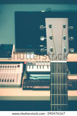 guitar in recording home studio + art filter for music background - stock photo