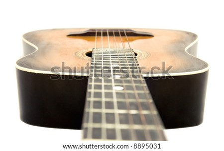 Guitar isolated on white. Camera a little higher strings. - stock photo