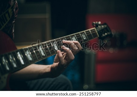 Guitar neck and hand chord selective focus - stock photo