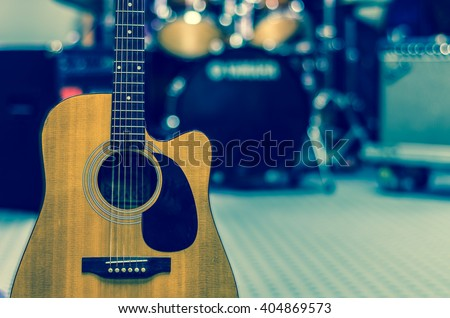 Guitar on music band background, musical concept - stock photo
