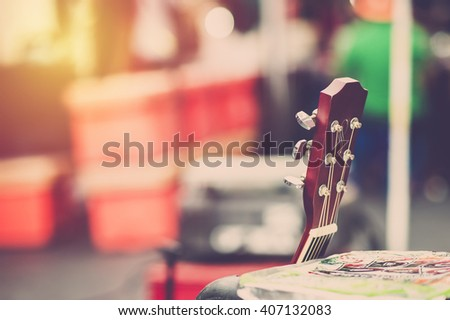 Guitar on stage. Vintage filter - stock photo