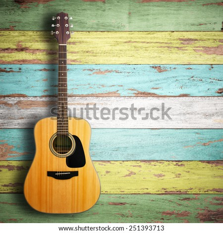 Guitar on wood background. - stock photo