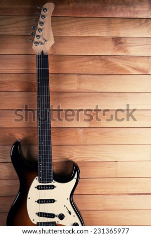 Guitar on wooden background - stock photo