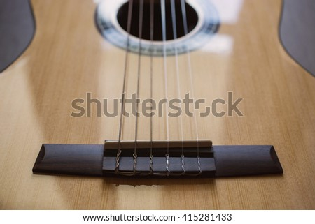 Guitar on wooden background, fretboard, stringed musical instruments, guitar details close up, solo instrument, blues, country, flamenco, rock, metal, jazz    - stock photo
