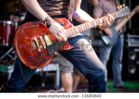 guitar player at rock concert - stock photo