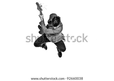 Guitar player jumping in the air - stock photo