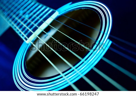 Guitar side view, strings and fingerboard with a shallow depth of field - stock photo