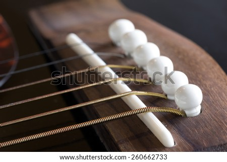 Guitar strings (focused on the nearest) - stock photo