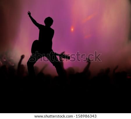 guitarist at rock concert - stock photo