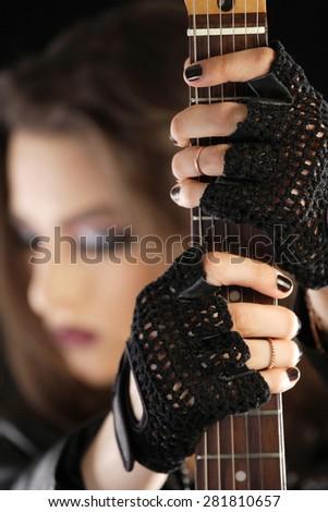 Guitarist holding her instrument - stock photo