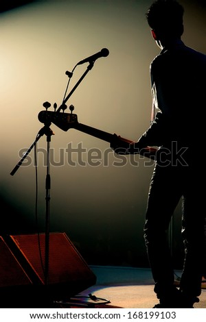 Guitarist of a pop band with a guitar - stock photo