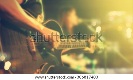 Guitarist on stage for background, soft and blur concept, Vintage color tone style - stock photo