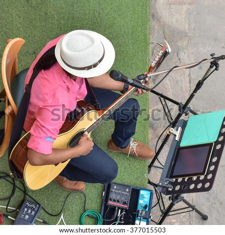 Guitarist on stage for background top view. - stock photo