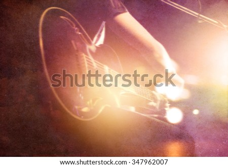 Guitarist on stage on paper grin background, soft and blur concept - stock photo