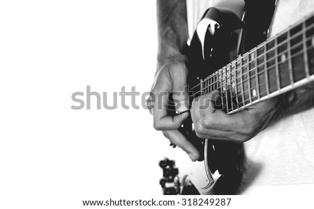 Guitarist on white background.  - stock photo