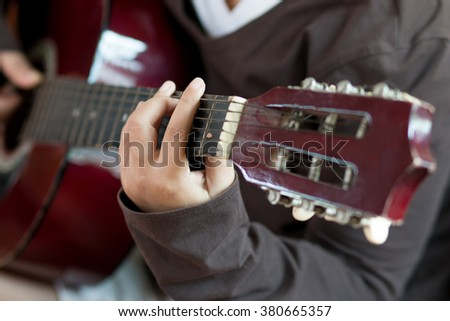 guitarist playing classic guitar - stock photo