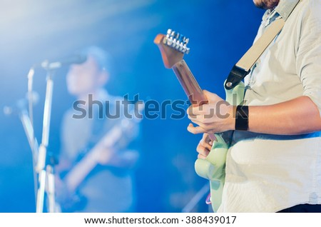 Guitarist show solo on stage, selective focus - stock photo