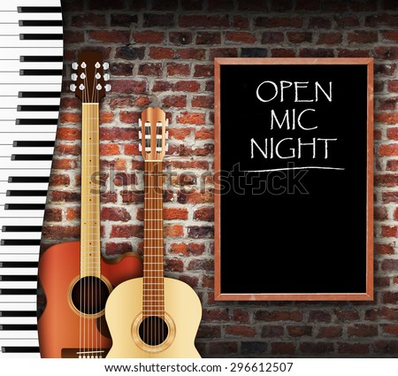 Guitars and keyboard against brick wall background and open mic night written on blackboard  - stock photo