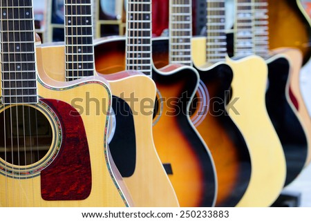 Guitars in the store background - stock photo