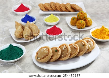 Gujiya and other Indian with Gulal or Face Powder at Holi - stock photo