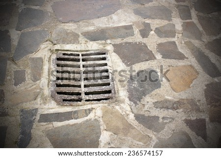 gully on old town street, urban pedestrian road - stock photo