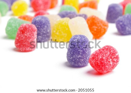 Gumdrop candies, focus is on purple candy in forefront only. Rest is blurred. - stock photo