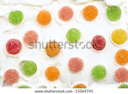 Gumdrops on Icing in a pattern for a tasty background - stock photo