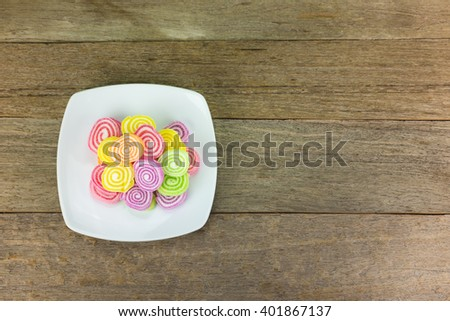Gummy candies stretched on wood . - stock photo