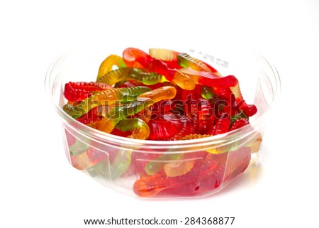 Gummy worms candies on white background, shallow focus - stock photo
