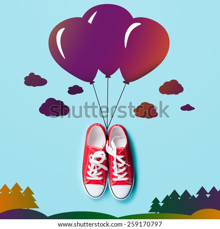 Gumshoes with abstract balloons in the sky over wood. - stock photo