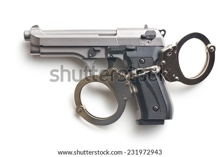 gun and handcuffs on white background - stock photo