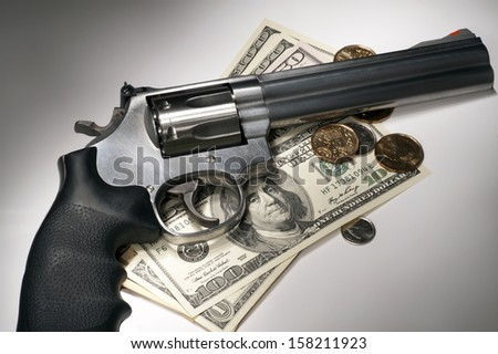 Gun and money - stock photo