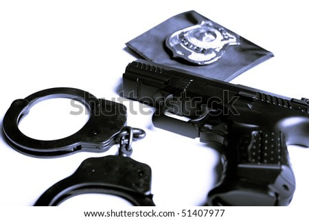 gun, handcuffs and police badge isolated - stock photo